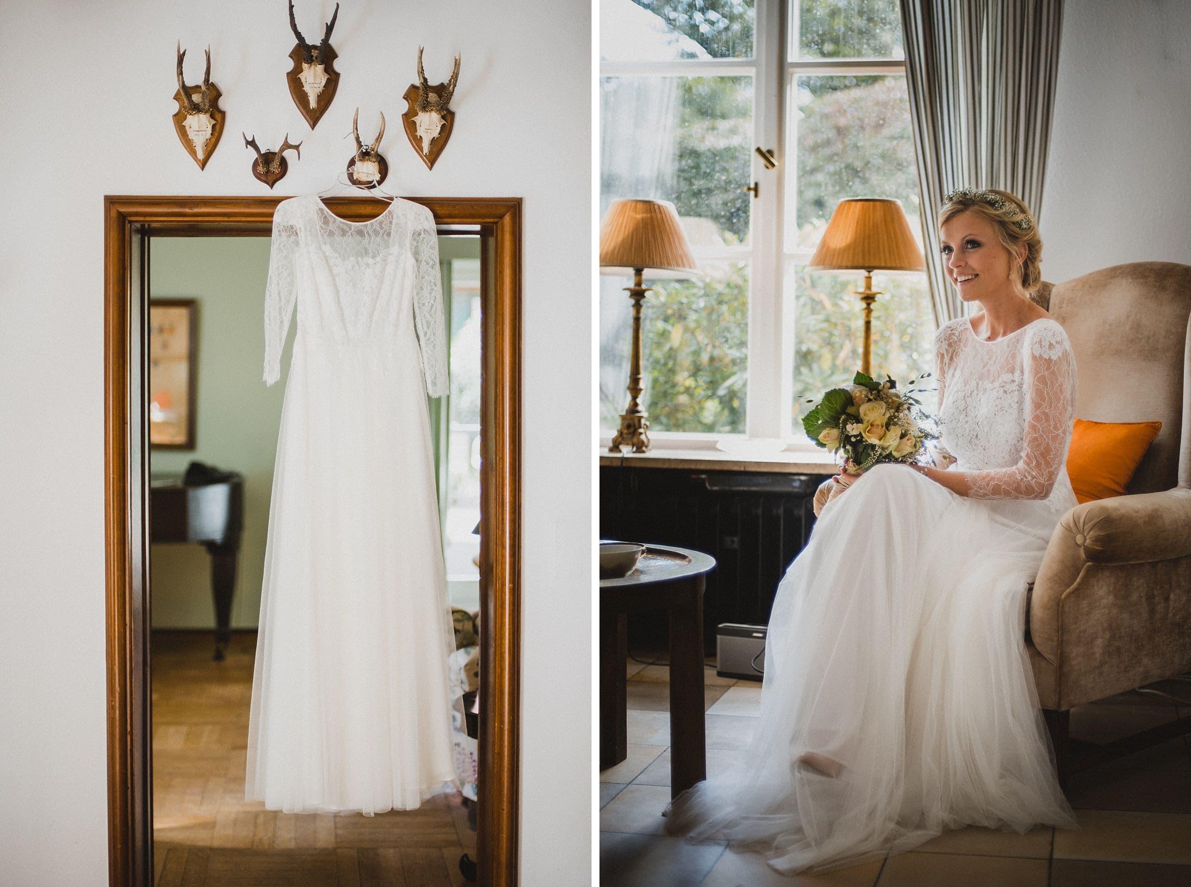 Hochzeitsfotografie Hamburg-Frau-Siemers-Gut Basthorst- Brautkleid hängt am Hirschgeweih